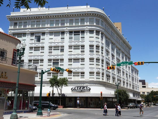 The former The Popular department store building at Mesa and San Antonio in Downtown has a Fallas discount store on the ground floor.
