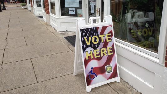 "This ""VOTE HERE"" sign shows one of the locations where early voting can take place at the Rutherford County Election Commission office on the south side of the Square in Murfreesboro."