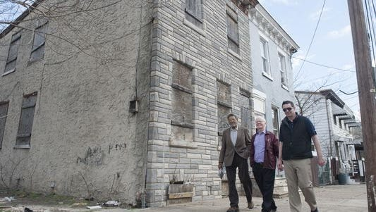 Kelly Francis, Father Michael Doyle and Patrick Duff walk outside the Camden home where they believe Martin Luther King Jr. lived while studying at a Pennsylvania seminary.