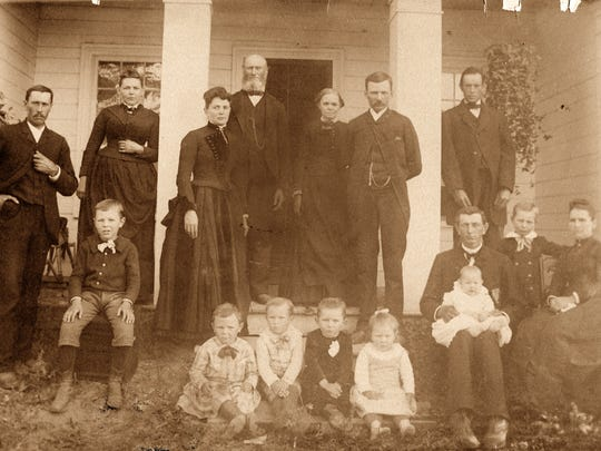 1889 Warner family photo, taken on the front porch of their house.  The original pioneers, Timothy and Lucretia Warner, are at center.