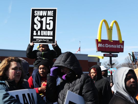 February 12, 2018 - Doneshia Babbitt holds her 6-year-old cousin, Tielynn Johnson, both of St. Louis, Mo., as they join protesters outside McDonald's, located at 2073 Union, demanding a $15 minimum wage. Members of the Fight for $15 invited union workers and labor activists from the Mid-South area for demonstrations to draw attention to minimum wage issues.