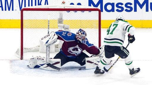 Colorado Avalanche goalie Philipp Grubauerr, left, is scored on by Dallas Stars' Alexander Radulov during first period NHL Western Conference Stanley Cup playoff action in Edmonton on Saturday.
