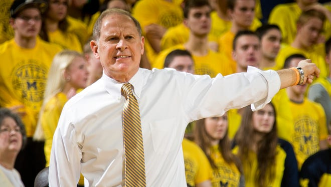Michigan basketball coach John Beilein gestures to his players against Michigan State on Saturday, Feb. 6, 2016.