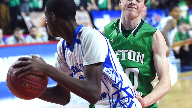 Seton Catholic's Leo Gallagher looks to stop Health Sciences Charter opponents, Class B, 2018 NYSPHSAA Boys Basketball Championships, Floyd L. Maines Veterans Memorial Arena, Binghamton, March 16, 2018.