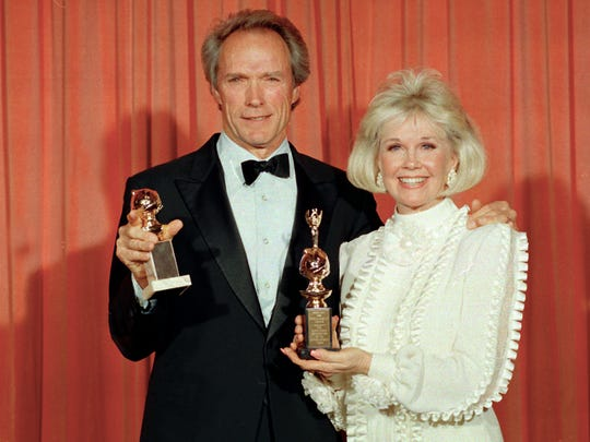 Clint Eastwood poses with Doris Day at the 46th annual Golden Globe Awards in Beverly Hills.