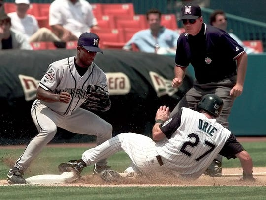 Florida Marlins' Kevin Orie (27) slides safely into