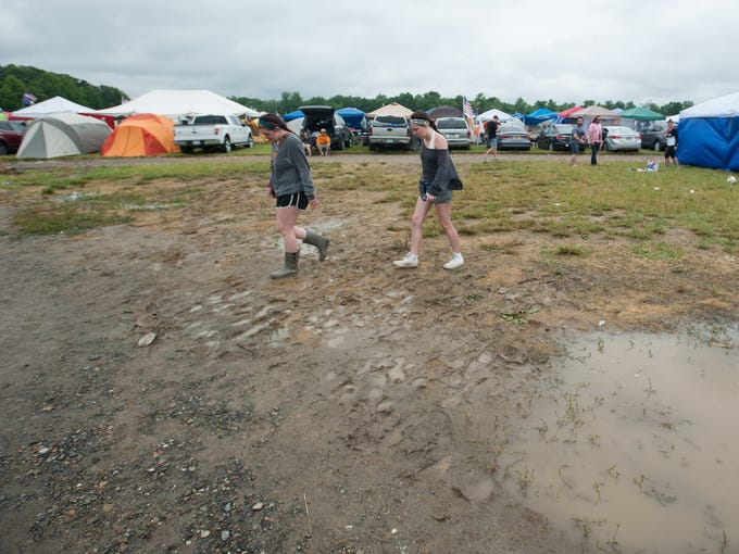 Campers avoid standing water in the camping area at