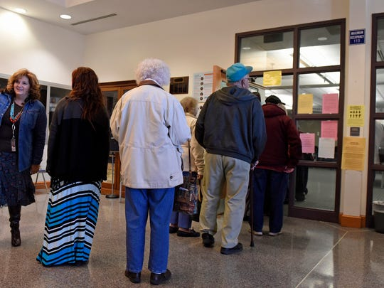 Registered voters stand in lines early Tuesday morning at a Chambersburg polling place at the Chambersburg Area School District building to vote during the general election.