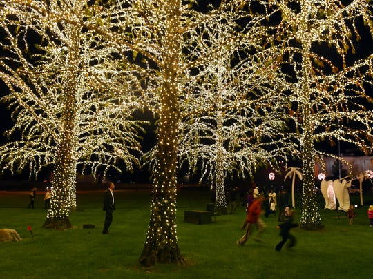 "Children play under the trees wrapped in holiday lights during Gaylord Opryland Resort & Convention Center's lighting ceremony Thursday, Nov. 19, 2015. This is the resort's 32nd ""A Country Christmas,"" which includes 2.3 million holiday lights."