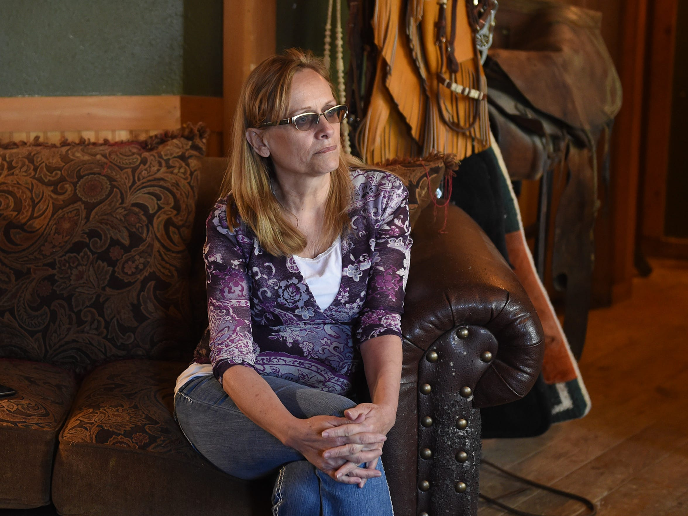 Konda Wakley sits in her home in Elko, Nevada as she