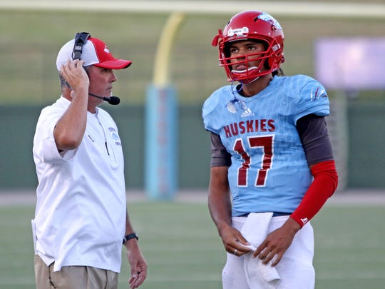 Hirschi quarterback Mar'tez Vrana talks to offensive coordinator Shane Adair during the game against Graham Thursday, Sept. 14, 2017, at Memorial Stadium. The Steers defeated the Huskies 42-35.