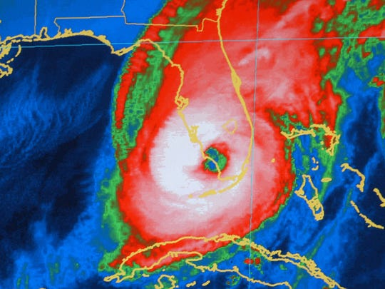In this file photo, this National Oceanic and Atmospheric Administration color-enhanced satellite image, the center of Hurricane Wilma comes ashore at Cape Romano, Fla., at about 6:30 a.m., Monday, Oct. 24, 2005, as a Category 3 storm with sustained winds measured at 125 mph.