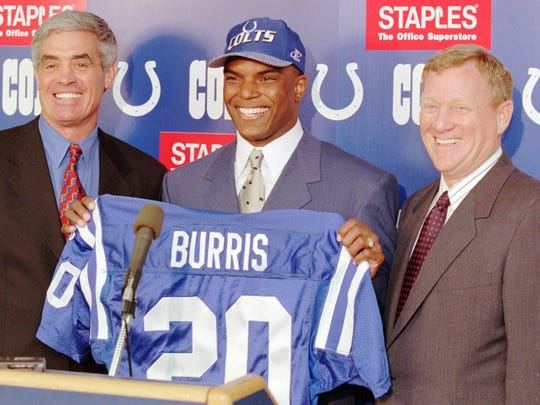 Jeff Burris, center, poses with Indianapolis Colts coach Jim Mora, left, and president Bill Polian on Feb. 18, 1998, after Burris agreed to a $20 million, five-year contract to play for the Colts.