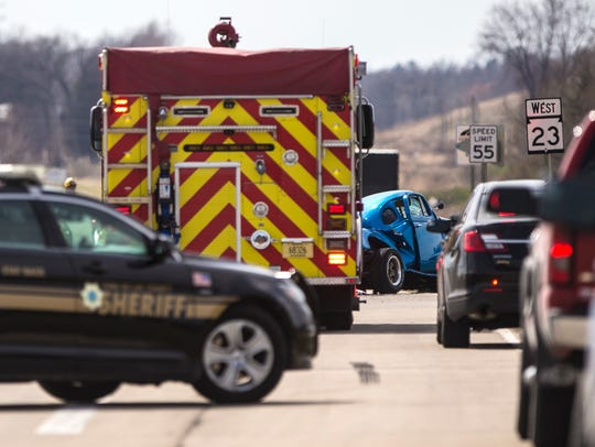 Emergency personel work the scene of a crash Monday,