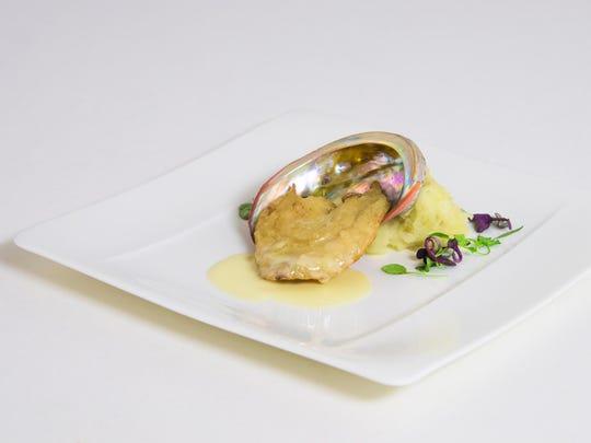 Course: California red abalone with Meyer lemon beurre blanc. Pairing: Peter Michael L'Après-Midi sauvignon blanc-semillon blend.
