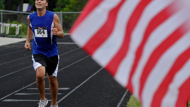 Running past an American Flag
