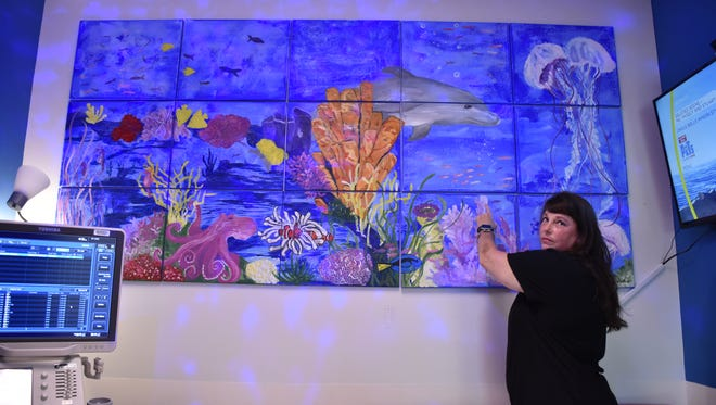 Nemour's sonographer and breast cancer survivor Miranda Bullock donates her paintings to the childcare facilities she works for in Pensacola.