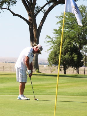Rob Tryon knocks in a long putt in this week's La Junta Seniors Golf League tournament Tuesday at the La Junta Municipal Golf Course.