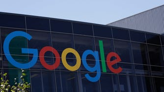 "The Google logo is seen at the company's headquarters in Mountain View, Calif. Google said Monday, Oct. 2, 2017,  it is ending its so-called ""first click free,"" a policy loathed by many publishers and media because it required a limited amount of free content from them before readers could be subjected to a paywall."