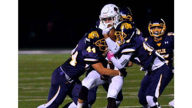 Brownwood High School wide receiver Braden Jetton is brought down by Wylie High School fullback Josh Goodnature (left) and defensive back Wyatt Wink during Friday's game Oct. 13, 2107. Wylie won in overtime, 45-38.