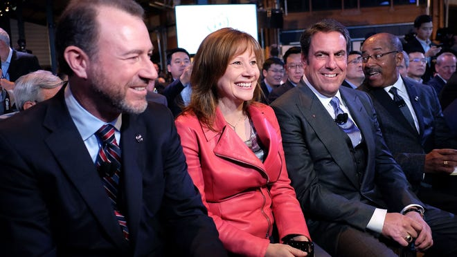 General Motors President Dan Ammann left, CEO Mary Barra, center, and GM Executive Vice President of Global Product Development Mark Reuss on the eve of the North American International Auto Show in Detroit on Jan. 11.