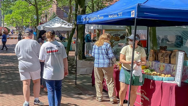 Customers and vendors flocked to the first day of this year's Corning Farmers Market Thursday in Riverfront Centennial Park.