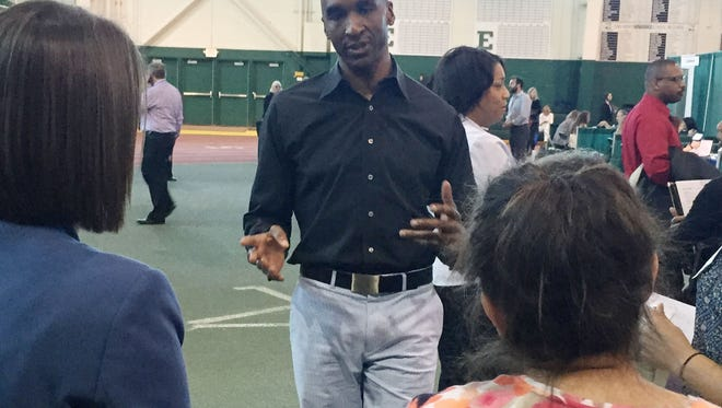 Ypsilanti Community Schools Superintendent Ben Edmondson talks to a group of job candidates during the 30th annual teacher job fair at Eastern Michigan University on Friday, April 15, 2016.