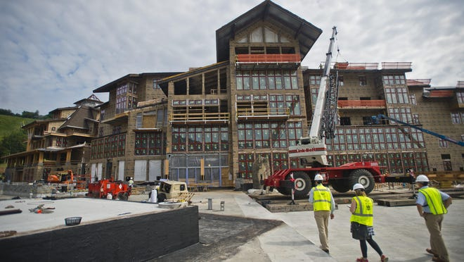 Construction of the latest in a series of building projects at Spruce Peak, part of Stowe Mountain Resort, includes an underground parking garage and geothermal heating and cooling.