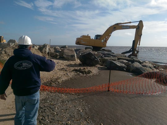 Kingfisher Environmental Services Inc. President Ted L. Mercer III looks on Monday as workers for his company resume construction of a 400-foot new jetty at Bowers Beach. The project, expected to be finished by February, was set back by about a week by a multi-day coastal storm.
