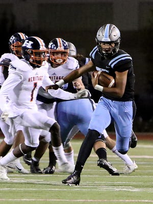 Southside's Javon Williamson breaks into the Heritage secondary in the first quarter for a long gain, Friday, Oct. 16, at Jim Rowland Stadium.