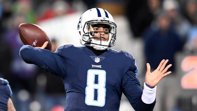 Titans quarterback Marcus Mariota (8) throws during the second half at Nissan Stadium on Dec. 31.