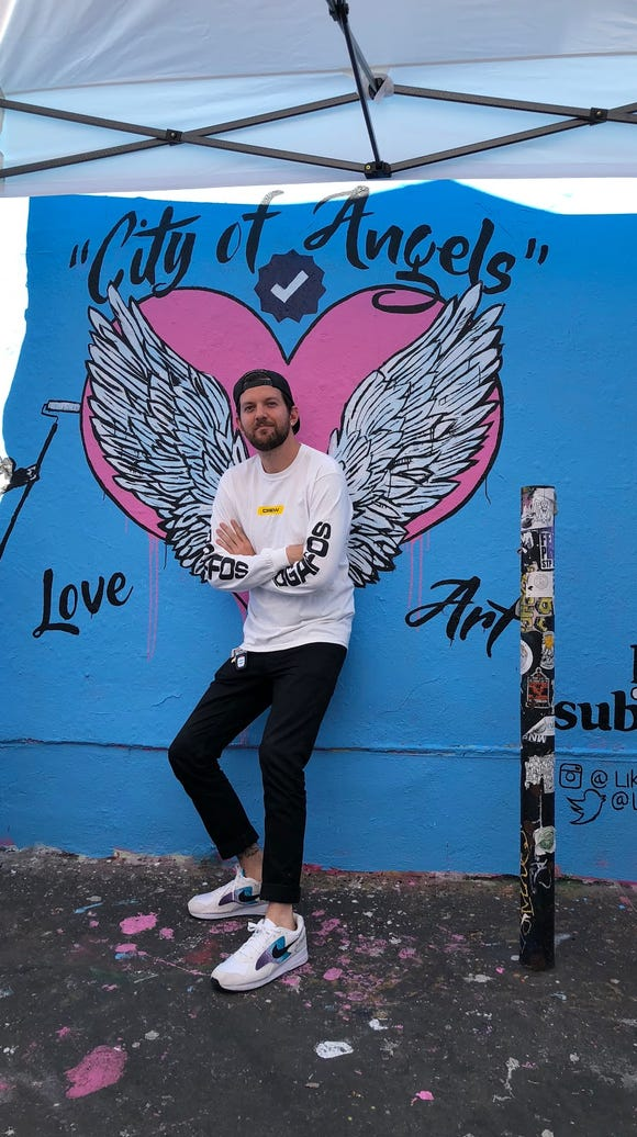 "Dillon Francis, the DJ and star of series ""Like and Subscribe,"" poses at a VIP mural that promotes his show"