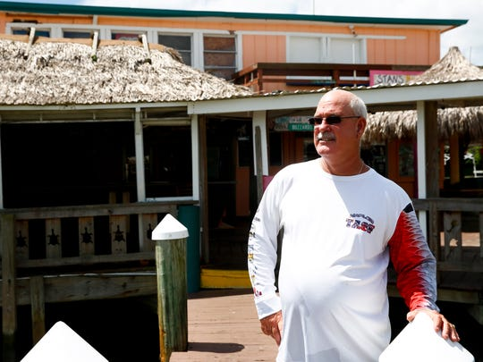 Steven Gober, current owner of Stan's Idle Hour in Goodland, Fla., stands outside his restaurant Tuesday, Aug. 22, 2017. Gober recalls pulling around the corner to see the wreckage Hurricane Andrew had caused to his father's restaurant and the entire fishing community 25 years ago.