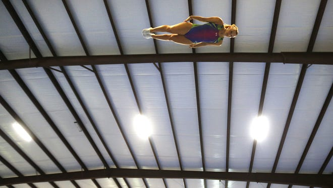 Trampoline gymnast Nicole Ahsinger practices her routine at the U.S. Gymnastics trials in Lafayette, La., on May 25, 2016. Ahsinger was scheduled to be among the competitors at the USA Gymnastics Championships in Milwaukee June 27-July 2, 2017.