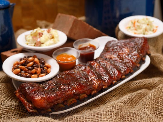 Full racks of BBQ ribs with sides were served at Dollywood's BBQ and Bluegrass Festival.