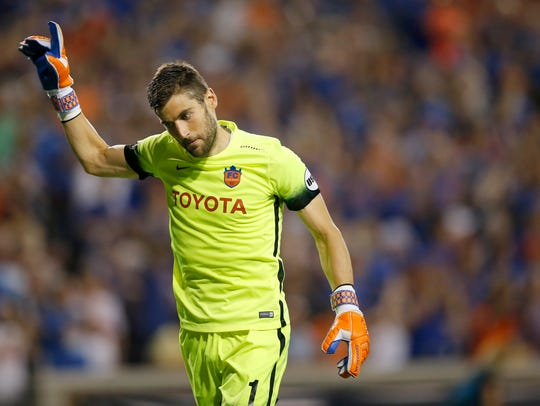 FC Cincinnati goalkeeper Mitch Hildebrandt (0) waves