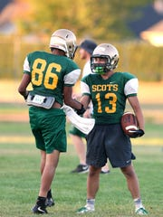 Emmanuel (Manny) Miranda, right, and teammates practice on Thursday, Aug. 18, 2016.