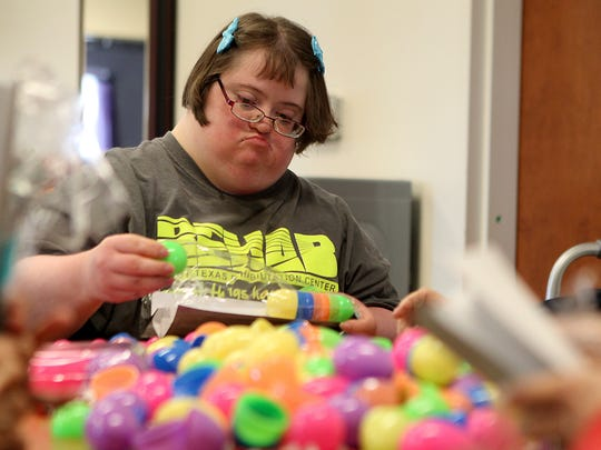 Laura Wilson, a client at Mosaic of San Angelo, helps