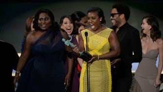 Uzo Aduba accepts the award for 'Orange Is the New Black' as outstanding ensemble in a comedy series during the 21st annual Screen Actors Guild Awards.