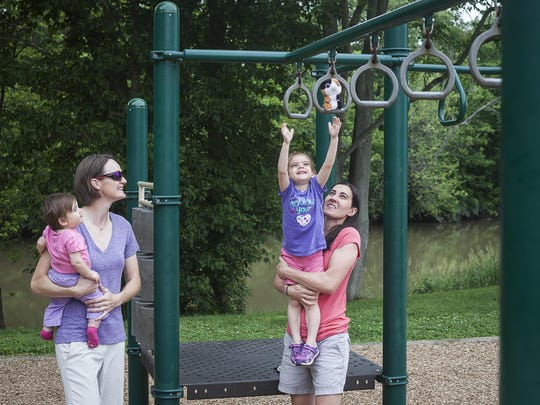 Katherine Mowat and her wife Mandy Harrison with their two daughters at Morrow's Meadow in Yorktown Wednesday.