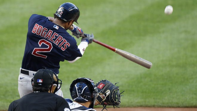 Boston's Xander Bogaerts hits a two-run home run during the first inning of Sunday's game.
