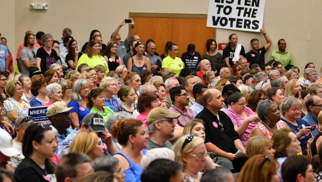 """A crowd packs the Viera High School Auditorium for an April 18 """"People's Town Hall"""" organized by Speak Out Brevard."""