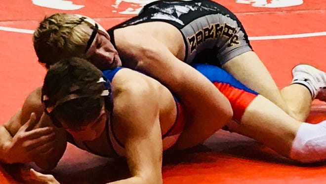 Projected state champ Conan Becker was one of four Northmor wrestlers to win in showdowns of state-ranked foes during last month's state dual team tournament in St. John Arena.