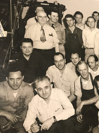 Printing staff at The Salinas Californian pose for a photo.