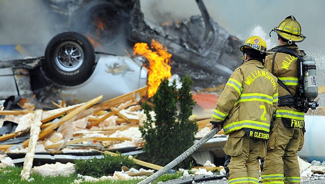 Firefighters work to put out fires following an explosion at a residence in Hancock, Md., Thursday.