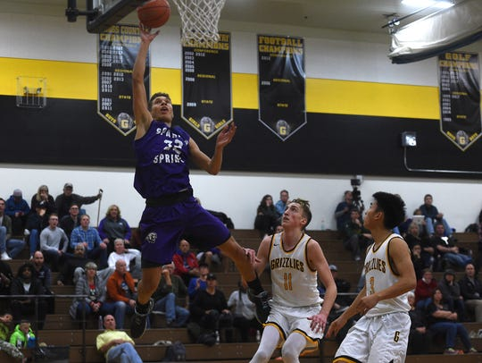 Spanish Springs' Jalen Townsell (32) drives to the