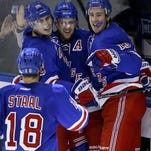 New York Rangers left wing Chris Kreider (20), center Derek Stepan (21) and right wing Kevin Hayes (13) celebrate after Stepan scored a goal against the Nashville Predators during the third period of an NHL hockey game, Monday, Nov. 23, 2015, in New York. The Rangers won 3-0.