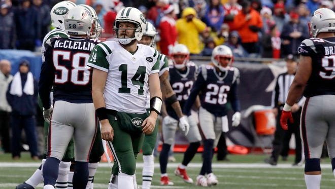 New York Jets quarterback Ryan Fitzpatrick (14) looks at the scoreboard after failing to make a first down against the New England Patriots during the first half of an NFL football game, Saturday, Dec. 24, 2016, in Foxborough, Mass. (AP Photo/Charles Krupa)