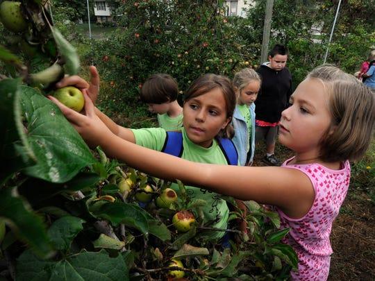 Third graders Hope Davis, center, and Natalie Breeden,