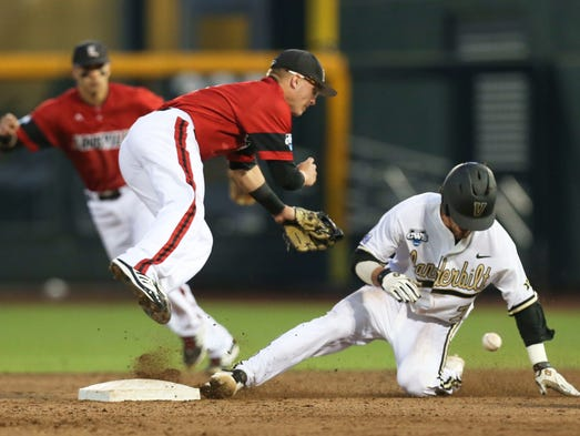 Louisville's Sutton Whiting can't make the catch to tag out Vanderbilt's Dansby Swanson Saturday at TD Ameritrade Park in Omaha. Swanson would go on to score a run in the fourth inning. June 14, 2014